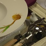 Table detail: the chicken holding cutlery
